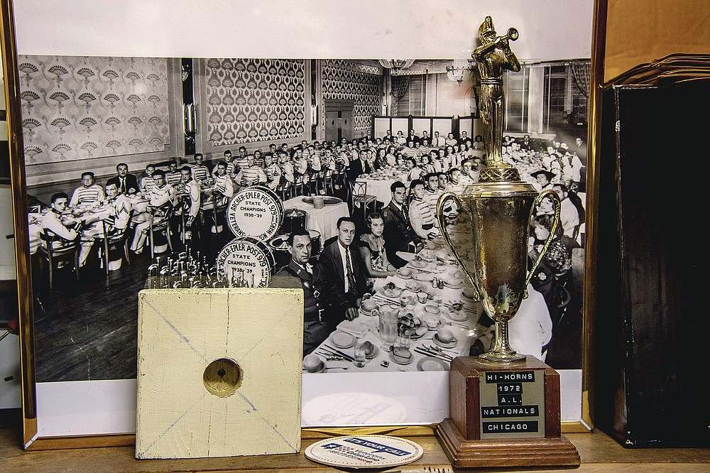 A photo of the 1938-39 State Champion Archer-Epler VFW Post 979 Musketeers Drum and Bugle Corps hangs on the wall at the post in Upper Darby, Pa., March 15, 2021. The post houses Bill Ives' collection of over 24,000 marching band and drum and bugle corps memorabilia. He was inducted into the World Drum Corps Hall of Fame in 2018.  (Tom Gralish/The Philadelphia Inquirer via AP)
