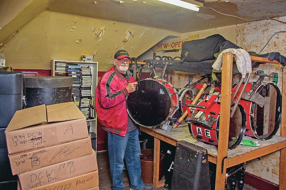 Bill Ives stands with drums at the Archer-Epler VFW Post 979 in Upper Darby, Pa., March 15, 2021. The post houses Ives' collection of over 24,000 marching band and drum and bugle corps memorabilia. He was inducted into the World Drum Corps Hall of Fame in 2018. (TomGralish/The Philadelphia Inquirer via AP)