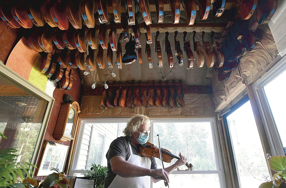 "Violin-maker Robert Gordon, of Belsano, Pa, performs ""Faded Love Song"" on one of his violins on Monday, March 22, 2021. (Todd Berkey/The Tribune-Democrat via AP)"