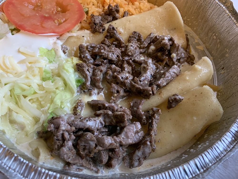 Enchiladas Tipicas come with melted cheese and grilled steak (or chicken) at Mojitos & Margaritas Grill & Bar in North Little Rock's Lakewood Village Shopping Center. (Arkansas Democrat-Gazette/Eric E. Harrison)