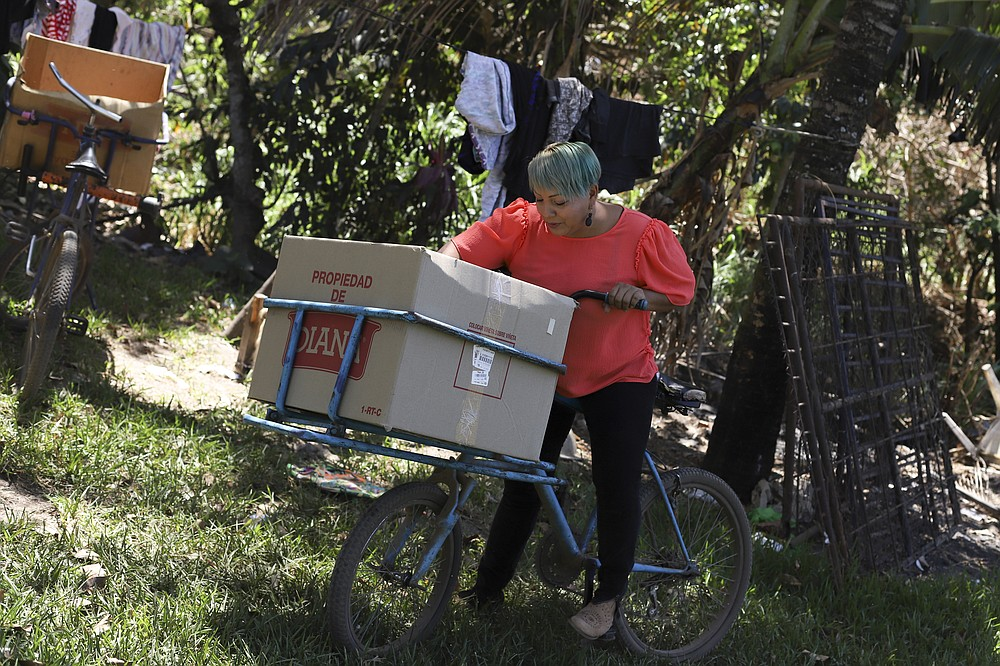 The Associated Press Iris Franco is seen at her home in El Ranchador, Santa Ana, El Salvador, on Friday, March 5. Franco runs a bakery at home and delivers the bread on a bike. The Salvadoran family lives humbly but is in a better place thanks to financial support from a family member in the United States who is part of the Temporary Protected Status program.