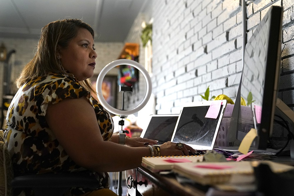 Irma Chavez works in her home office on Tuesday, March 9, in Springdale. Chavez came to the United States from her home in El Salvador in 1994 when she was 18 and later was granted temporary protected status.