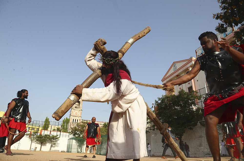 Christians reenact the crucifixion of Jesus Christ to mark Good Friday in Hyderabad, India, Friday, April 2, 2021. Christians all over the world attend mock crucifixions and passion plays that mark the day Jesus was crucified, known to Christians as Good Friday. (AP Photo/Mahesh Kumar A.)