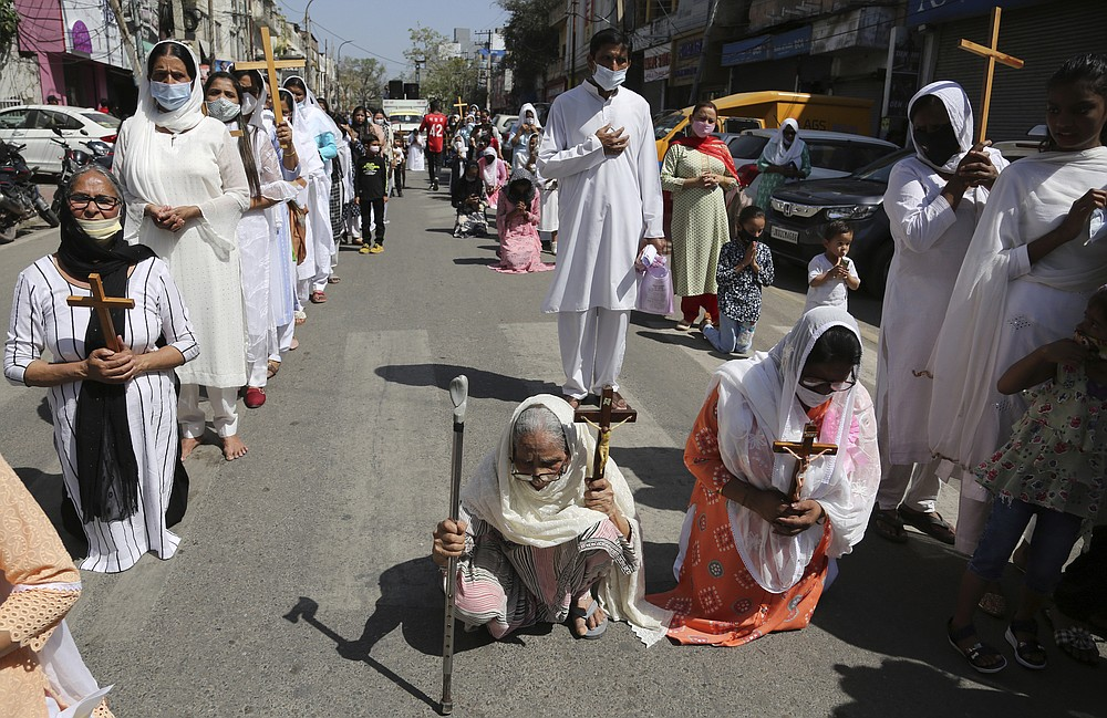Christians participate in a procession to mark Good Friday in Jammu, India, Friday, April 2, 2021. Christians all over the world attend mock crucifixions and passion plays that mark the day Jesus was crucified, known to Christians as Good Friday. (AP Photo/Channi Anand)