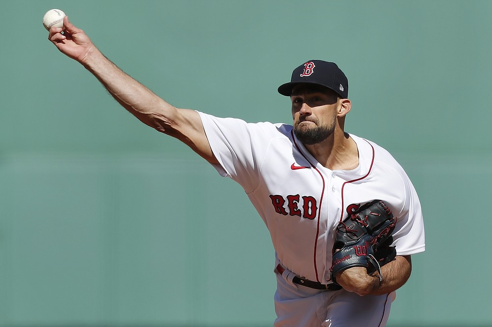 Boston Red Sox's Nathan Eovaldi pitches during the first inning of an opening day baseball game against the Baltimore Orioles, Friday, April 2, 2021, in Boston. (AP Photo/Michael Dwyer)
