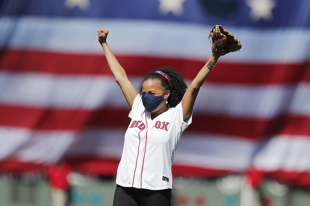 Acting Mayor of Boston Kim Janey reacts after throwing out the ceremonial first pitch before an opening day baseball game between the Boston Red Sox and the Baltimore Orioles, Friday, April 2, 2021, in Boston. (AP Photo/Michael Dwyer)