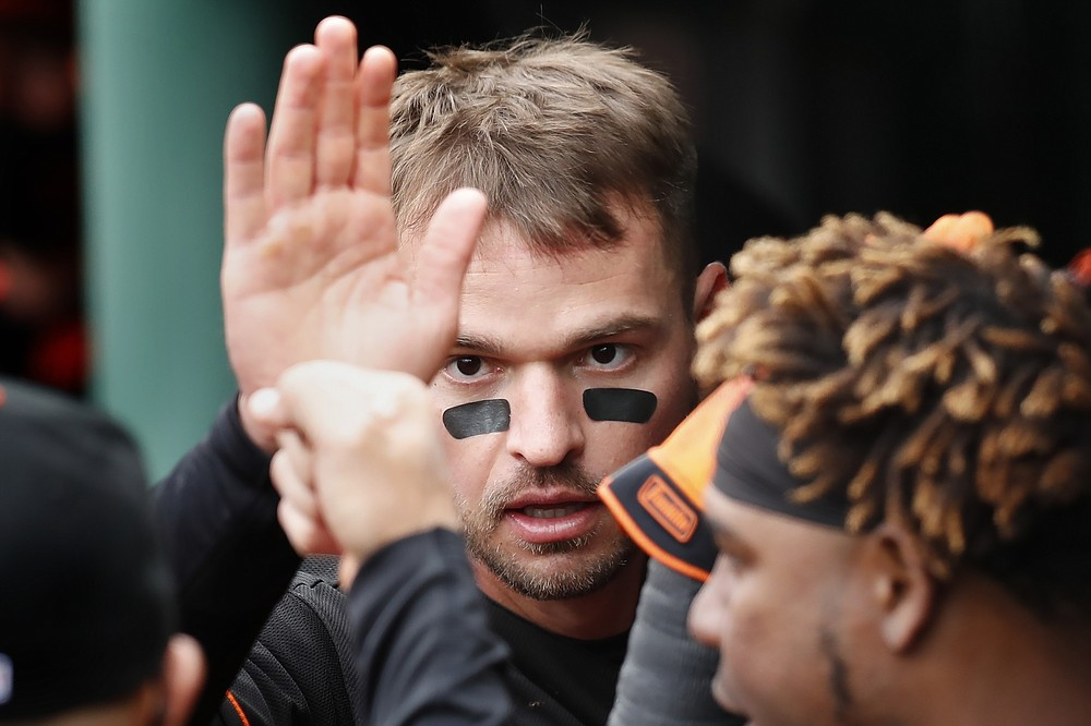 Baltimore Orioles' Trey Mancini celebrates after scoring on a two-run double by Ryan Mountcastle during the sixth inning of an opening day baseball game against the Boston Red Sox, Friday, April 2, 2021, in Boston. (AP Photo/Michael Dwyer)