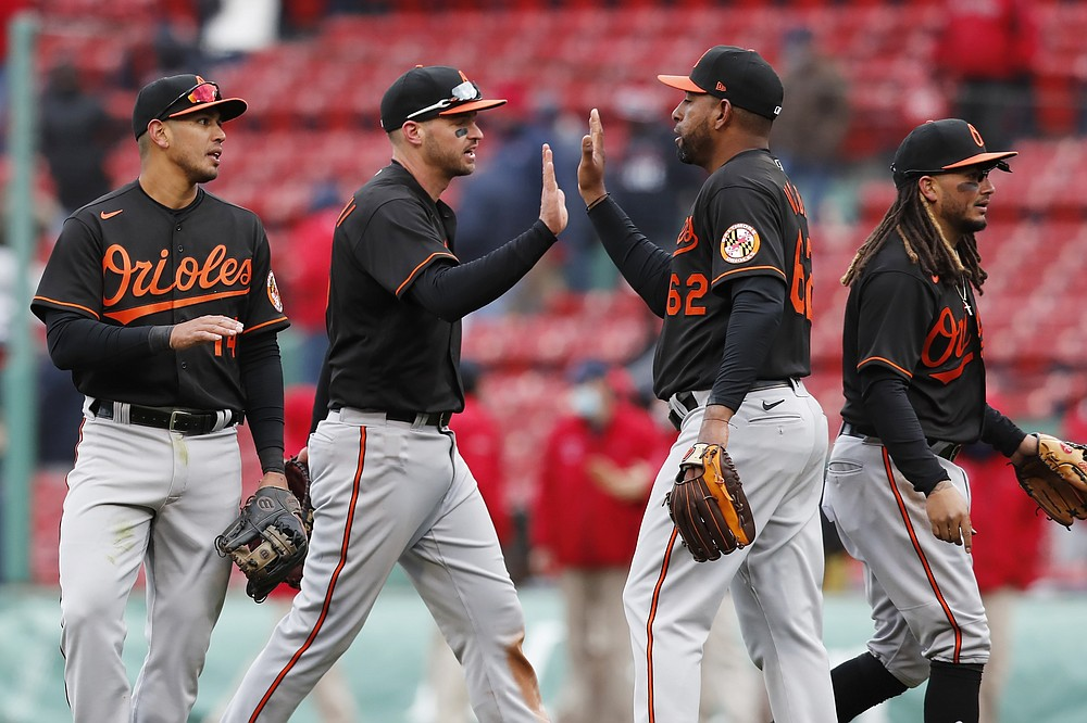 Baltimore Orioles' Cesar Valdez (62) celebrates with teammates after defeating the Boston Red Sox during an opening day baseball game, Friday, April 2, 2021, in Boston. (AP Photo/Michael Dwyer)