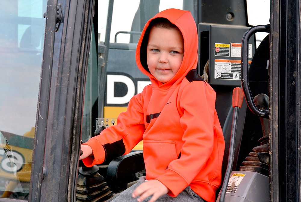 Marc Hayot/Herald-Leader Hank Griffin is ready to start digging in a Kubota dozer the city provided for kids to come touch and play in the massive vehicles.