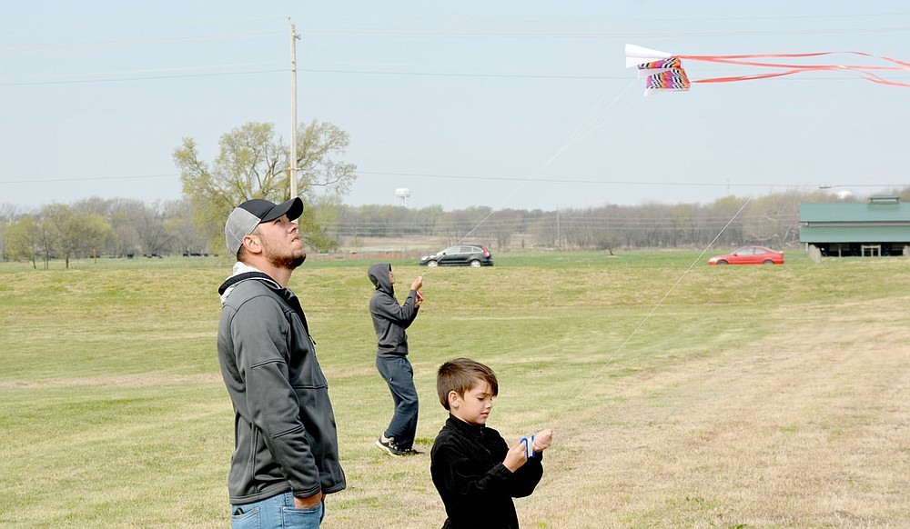 Marc Hayot/Herald-Leader Malachi Matlow (right) came out during kite day to fly his kite high as Michael Meadows looks on.