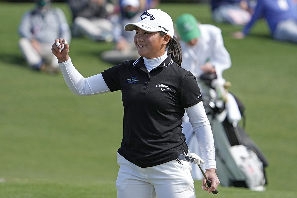 Tsubasa Kajitani, of Japan, celebrates after beating Emilia Migliaccio on the first playoff hole to win the Augusta National Women's Amateur golf tournament at Augusta National Golf Club, Saturday, April 3, 2021, in Augusta, Ga. (AP Photo/David J. Phillip)
