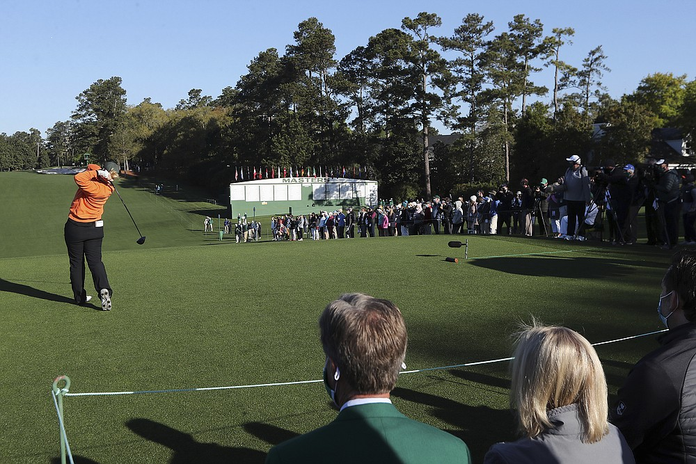 A limited number of fans return lining the first fairway at Augusta National Golf Club to watch Maja Stark tee off on the first hole during the Augusta National Women's Amateur final round on Saturday, April 3, 2021, in Augusta, Ga.  (Curtis Compton /Atlanta Journal-Constitution via AP)