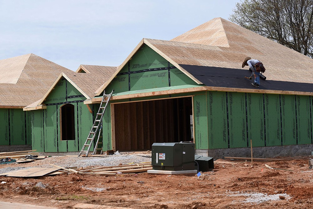 Dozens of homes are under construction at Park View subdivision in Lowell, seen March 30 2021, being built by Riverwood Homes. (NWA Democrat-Gazette/Flip Putthoff)