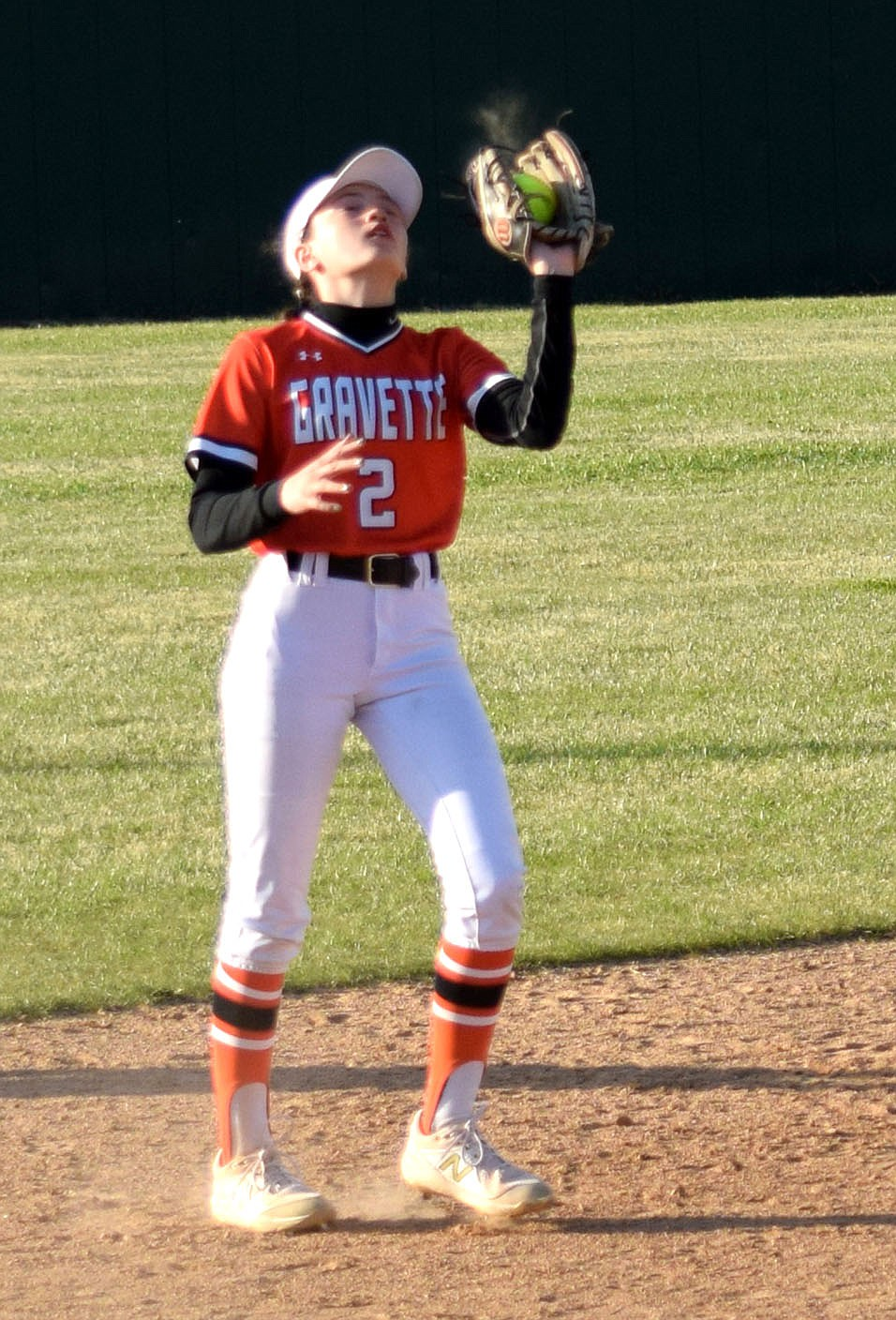 Westside Eagle Observer/MIKE ECKELS  Lady Lion Brynne Romine catches a popup fly to her short stop position for a Lady Pioneer out during the sixth inning of the Friday night Gravette-Gentry softball contest in Gravette. the Lady Pioneers took the conference win 10-7 over the Lady Lions.
