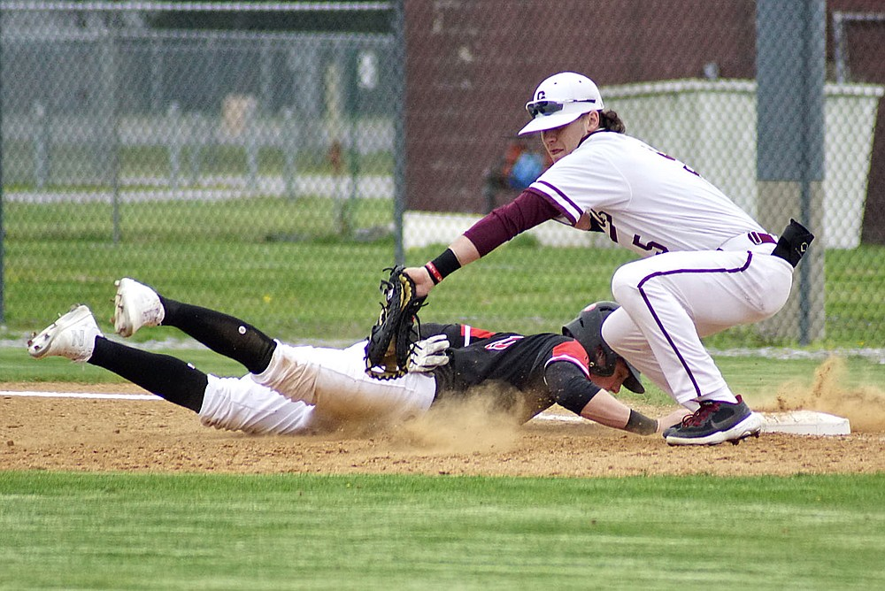Westside Eagle Observer/RANDY MOLL Gentry first baseman Garry Cox puts the tag on a Pea Ridge base runner in a pickoff attempt on March 30 at Gentry High School.