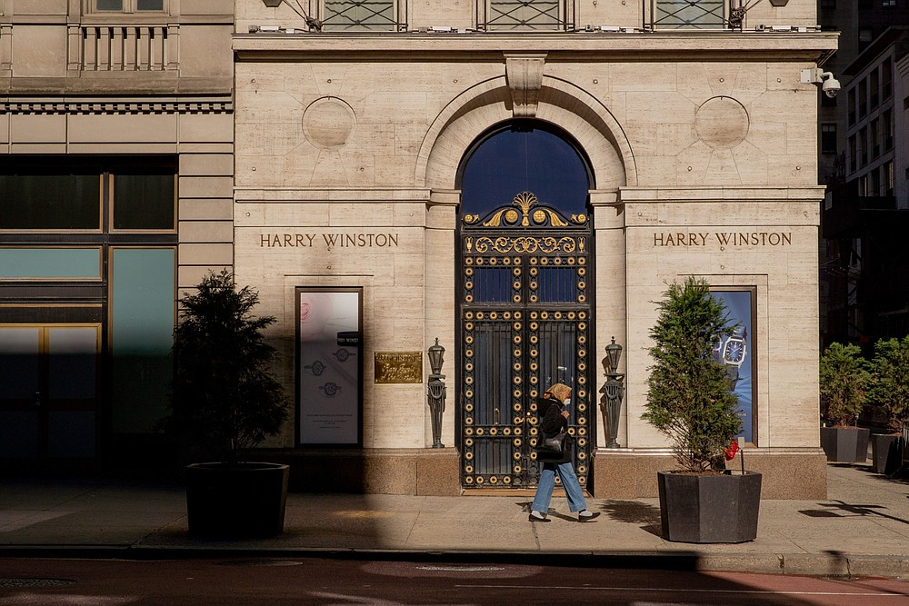 A pedestrian walks past luxury jeweler Harry Winston at 712 Fifth Avenue in New York on March 30, 2021. MUST CREDIT: Bloomberg photo by Amir Hamja.