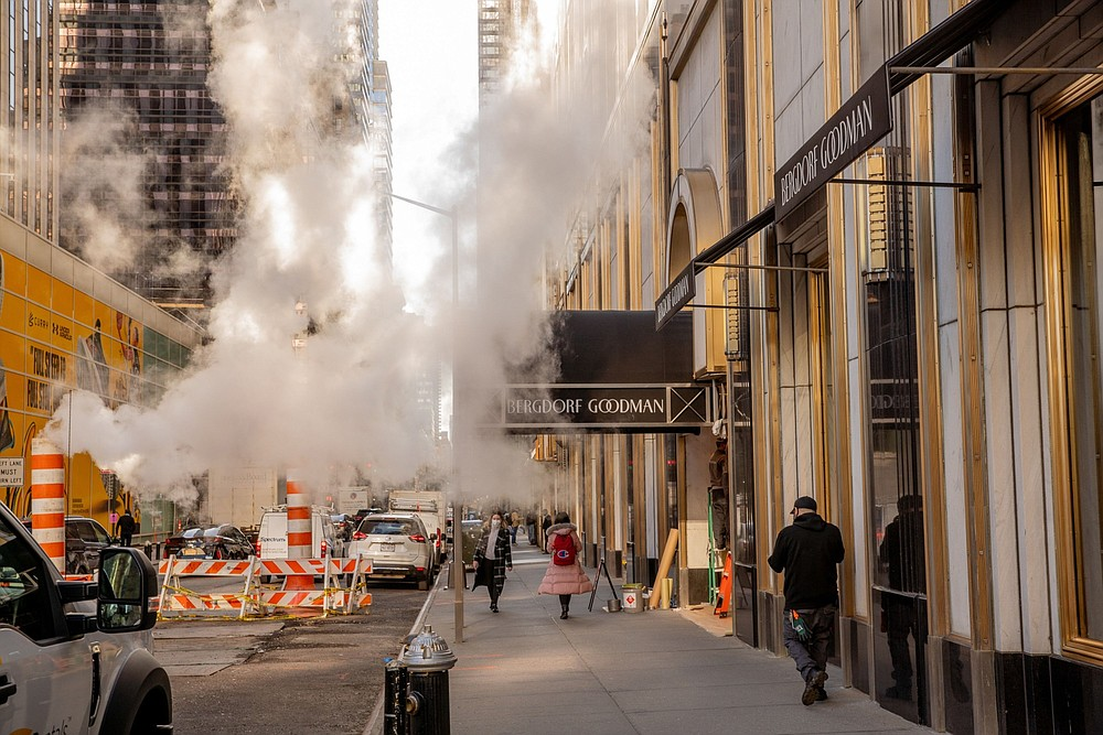 Pedestrians pass the Bergdorf Goodman luxury department store on Fifth Ave. in New York on March 30, 2021.. MUST CREDIT: Bloomberg photo by Amir Hamja.