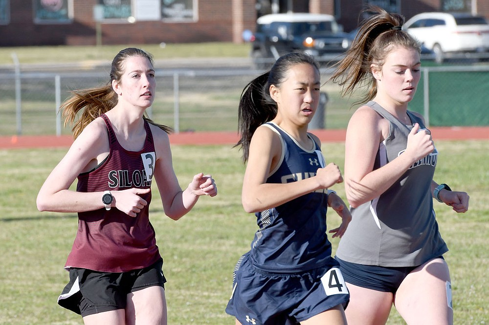 Bud Sullins/Special to the Herald-Leader Shayla Conley, left, runs in the 1,600-meter run in the Panther Relays at Glenn W. Black Stadium.