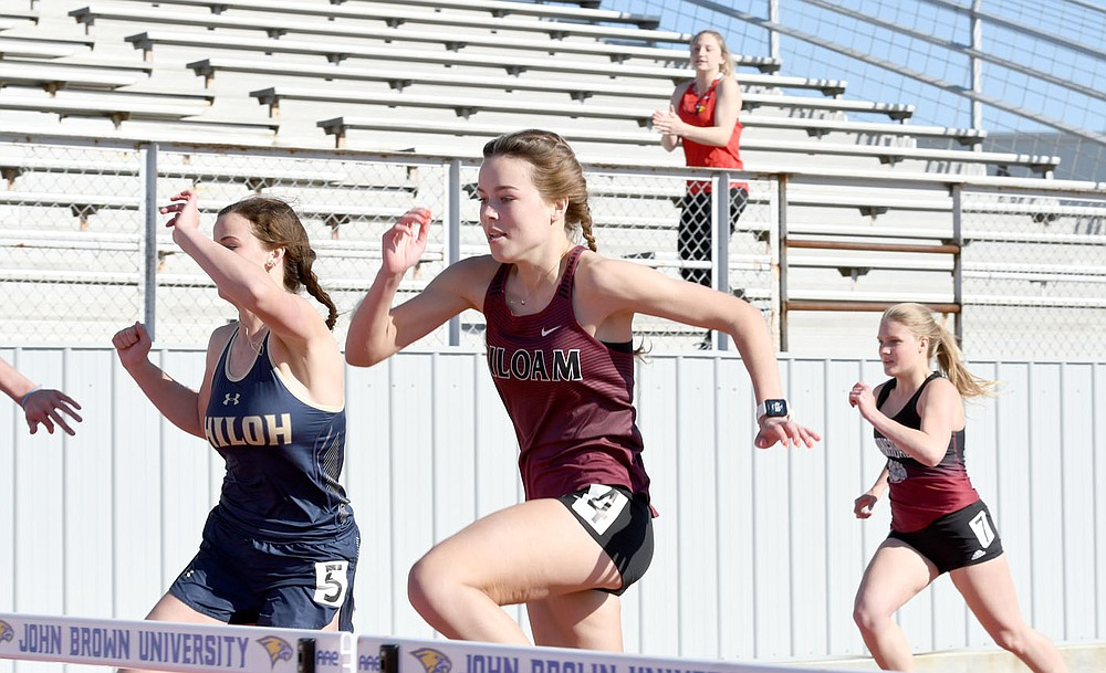 Bud Sullins/Special to the Herald-Leader Siloam Springs senior Quincy Efurd runs the hurdles during the Panther Relays on April 1 at Glenn W. Black Stadium.