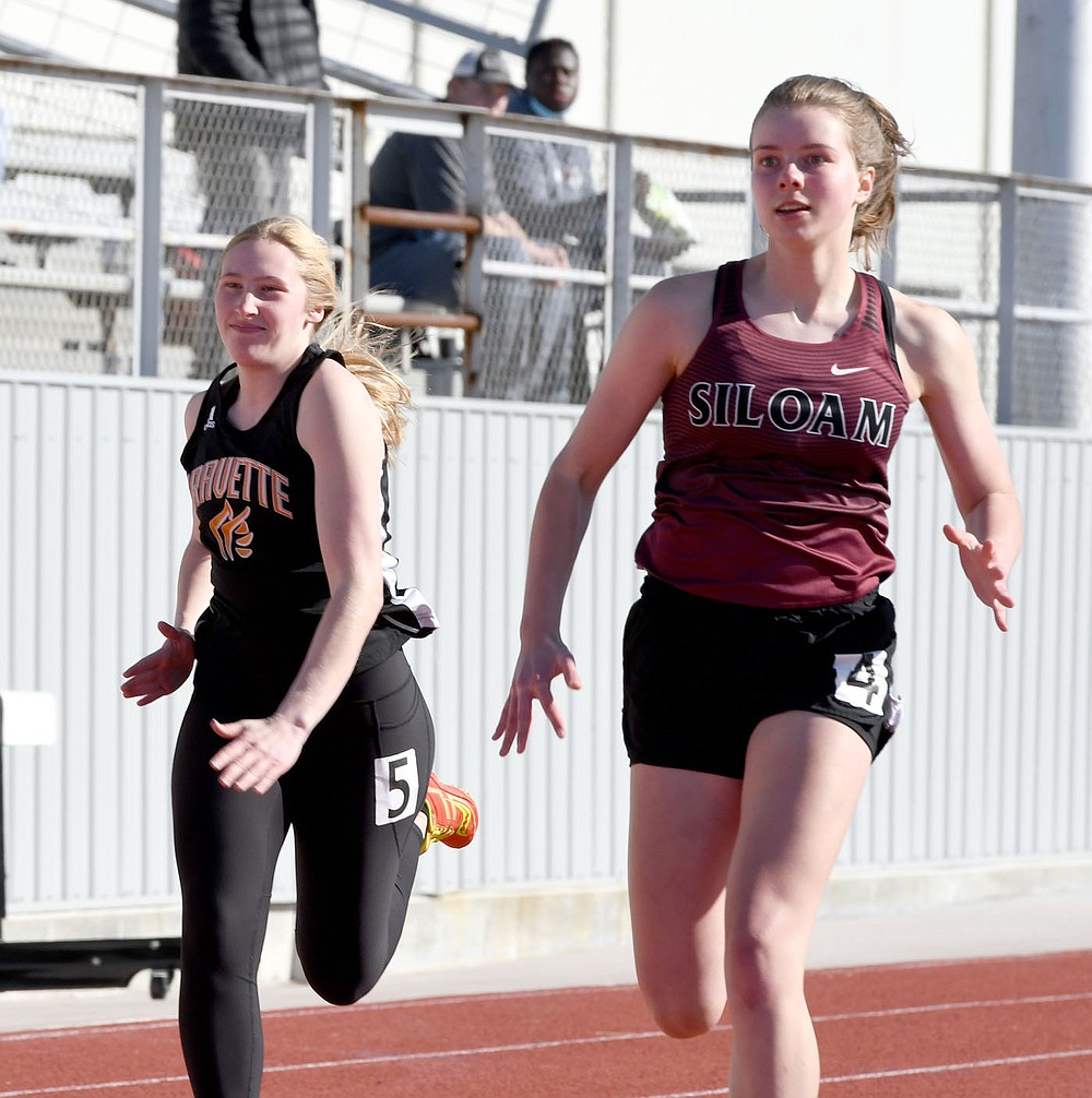 Bud Sullins/Special to the Herald-Leader Esther Norwood runs in the Panther Relays on April 1 at Glenn W. Black Stadium.