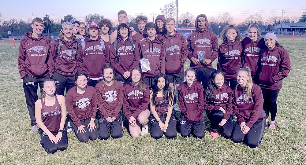 Photo submitted The Siloam Springs boys and girls track teams pose for a team photo after the Panther Relays on April 1 at Glenn W. Black Stadium. The Panthers won the meet while the Lady Panthers finished fourth.
