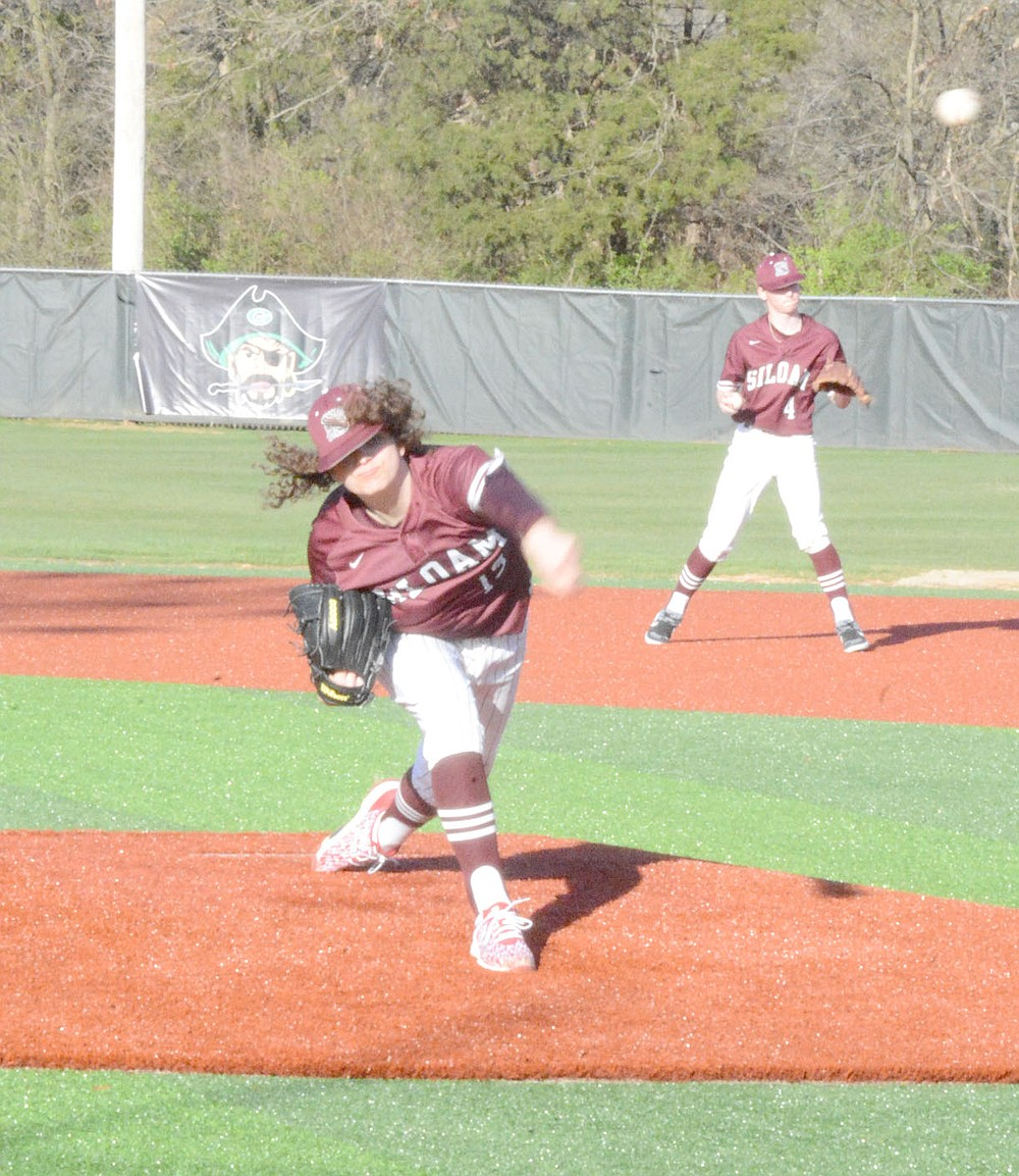 Graham Thomas/Herald-Leader Siloam Springs sophomore Spencer Stephenson throws a pitch against Pea Ridge in a game played at Greenland on March 26.