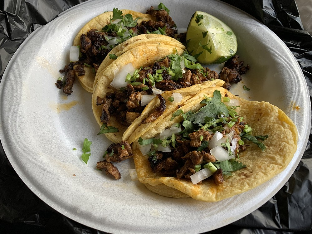 We got three street tacos al pastor from the Tacos Atilano truck on Pike Avenue in North Little Rock. (Arkansas Democrat-Gazette/Eric E. Harrison)