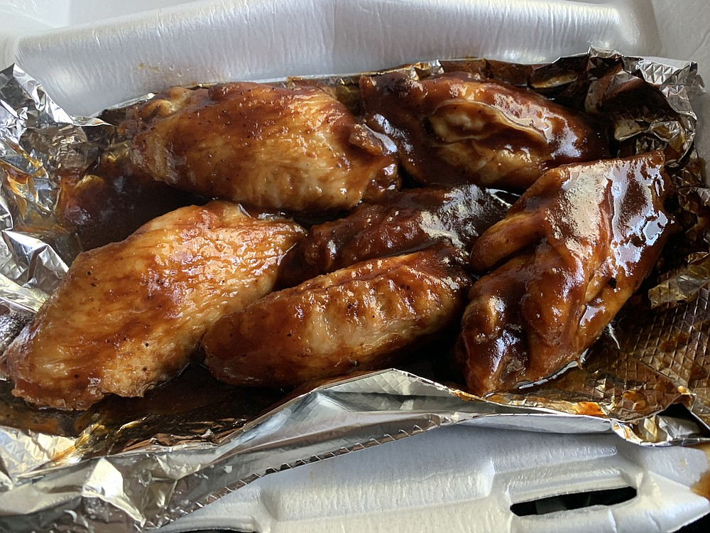 We had a half-hour wait for a half-dozen wings awash in a honey barbecue sauce from the WangzNThangz food truck. (Arkansas Democrat-Gazette/Eric E. Harrison)