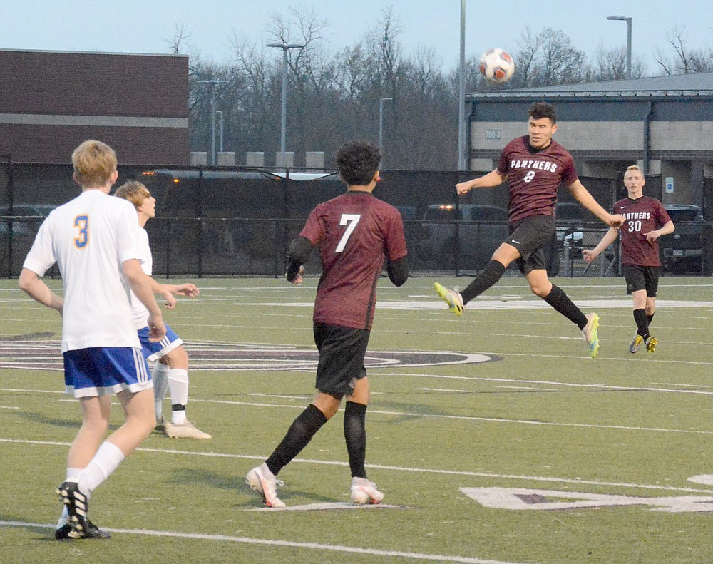 Graham Thomas/Herald-Leader Siloam Springs junior Jason Flores goes up to head a ball against Mountain Home on March 12.