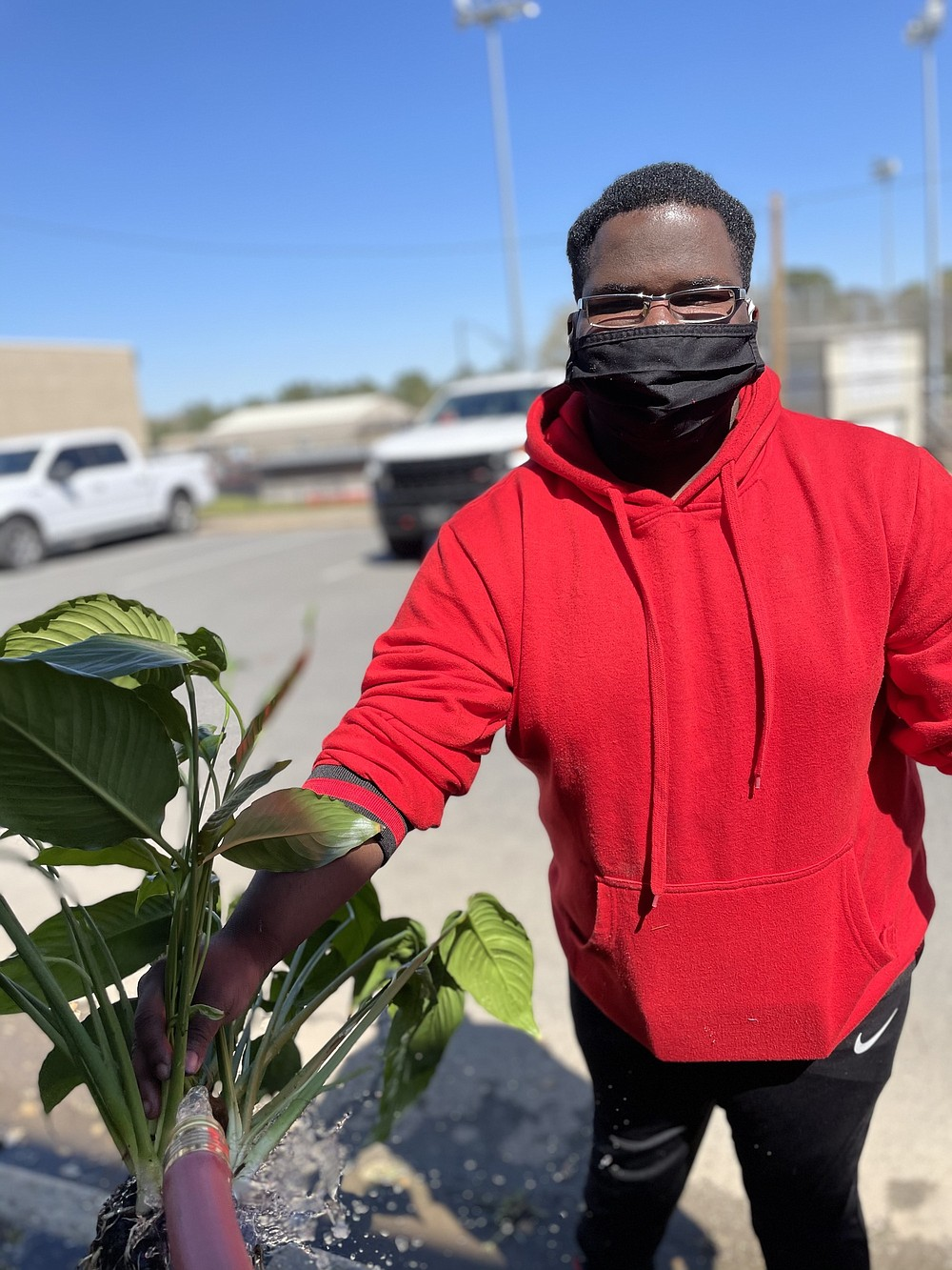 White Hall High School senior Jalyon Shaw is part of the Survey of Agriculture and is caring for one of the program's plants. (Special to The Commercial)
