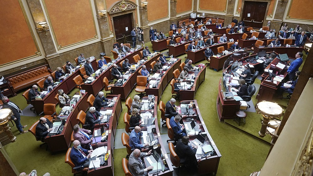 FILE - The Utah House of Representatives is shown on Feb. 26, 2021, in Salt Lake City. Utah's governor has signed a law requiring biological fathers to pay half of a woman's out-of-pocket pregnancy costs. (AP Photo/Rick Bowmer, File)