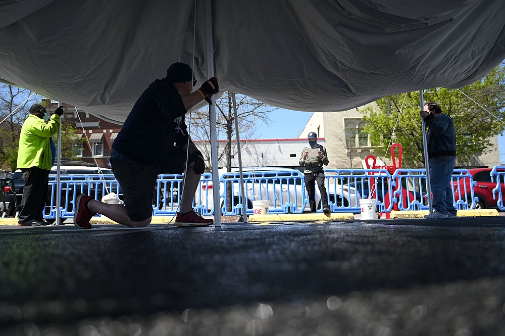 Workers erect tents and barricades April 2 for the SoMa Outdoor Dining room. (Arkansas Democrat-Gazette/Stephen Swofford)