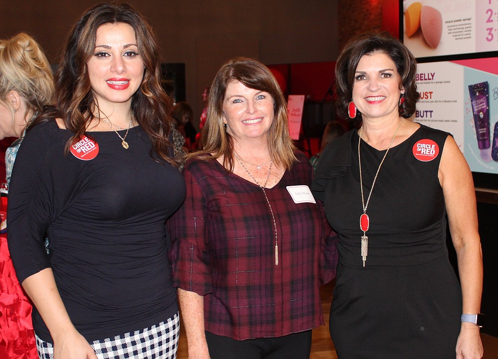 NWA Democrat-Gazette/CARIN SCHOPPMEYER Silvia Azrai-Kawas (from left), Jody Penson and Debbie Alsup, 2020 Go Red for Women co-chairwomen, welcome American Heart Association supporters to the Healthy, Beautiful You Circle of Red kick-off Oct. 3 at Haxton Road Studios in Bentonville.