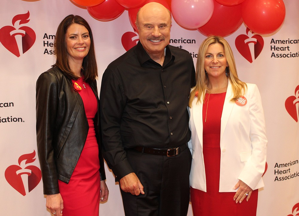 NWA Democrat-Gazette/CARIN SCHOPPMEYER Diana Marshall (left) and Kimberly Joubert, Go Red for Women co-chairwomen, visit with Dr. Phill McGraw after the American Heart Association fundraiser May 21.