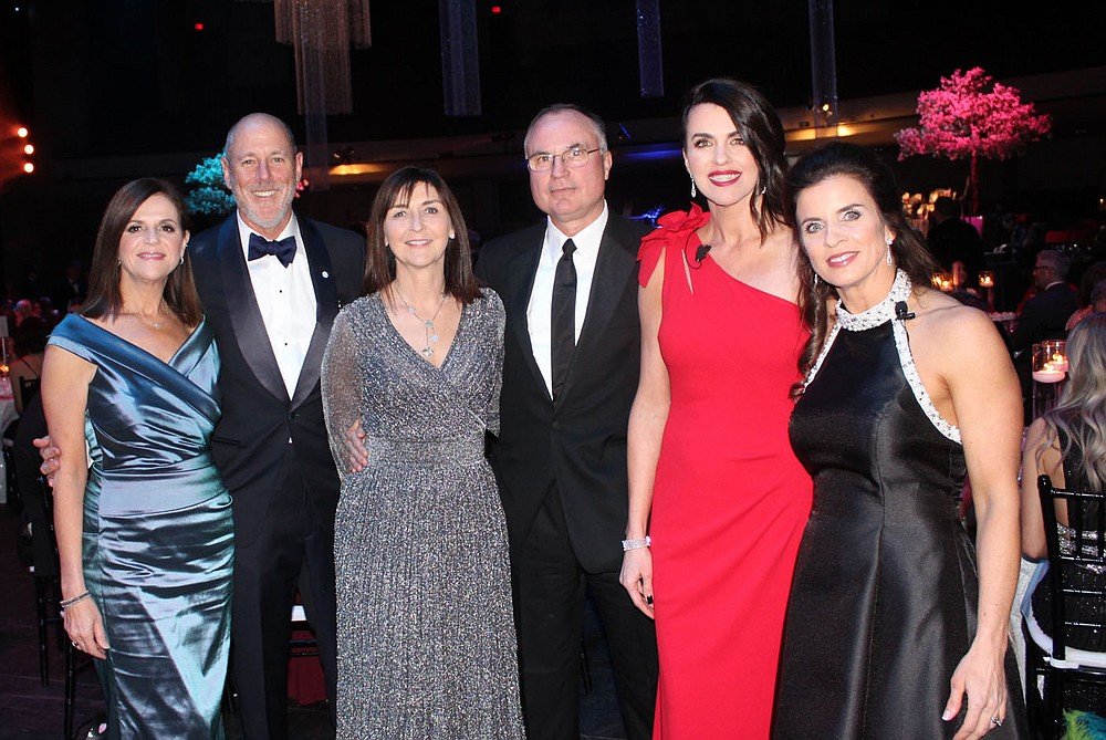 Barbara Putman and Peter Lane, Walton Arts Center CEO (from left); Masquerade Ball honorary chairwoman Judith McKenna and Phil Dutton; Megan Timberlake and Jessica Hendrix, event co-chairwomen, welcome guests to the benefit Feb. 22 at the arts center in Fayetteville.  (NWA Democrat-Gazette/Carin Schoppmeyer)