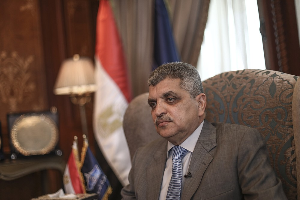 The Suez Canal chief Lt. Gen. Osama Rabie sits during an interview in Ismailia, Egypt, Tuesday, April 6, 2021. The Suez Canal chief said that authorities are negotiating a financial settlement with the owners of a massive vessel that blocked the crucial waterway for nearly a week. (AP Photo/Mohamed Elshahed)