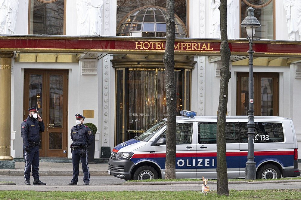 Police officers stand in front of Hotel Imperial where a delegation from Iran is staying in Vienna, Austria, Tuesday, April 6, 2021. Foreign ministry officials from the countries still in the accord, the so-called Joint Comprehensive Plan of Action, are meeting in Vienna to push forward efforts to bring the United States back into the 2015 deal on Iran's nuclear program. (AP Photo/Florian Schroetter)