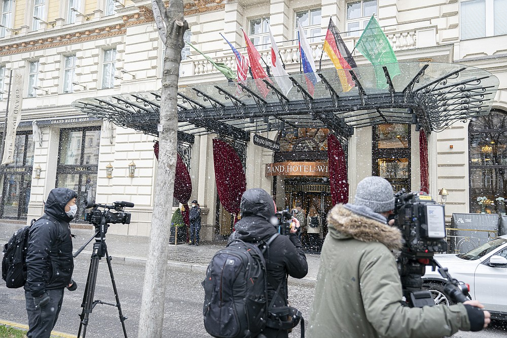 Journalists wait in front of the Grand Hotel Wien where closed-door nuclear talks with Iran take place in Vienna, Austria, Tuesday, April 6, 2021. Foreign ministry officials from the countries still in the accord, the so-called Joint Comprehensive Plan of Action, are meeting in Vienna to push forward efforts to bring the United States back into the 2015 deal on Iran's nuclear program. (AP Photo/Florian Schroetter)
