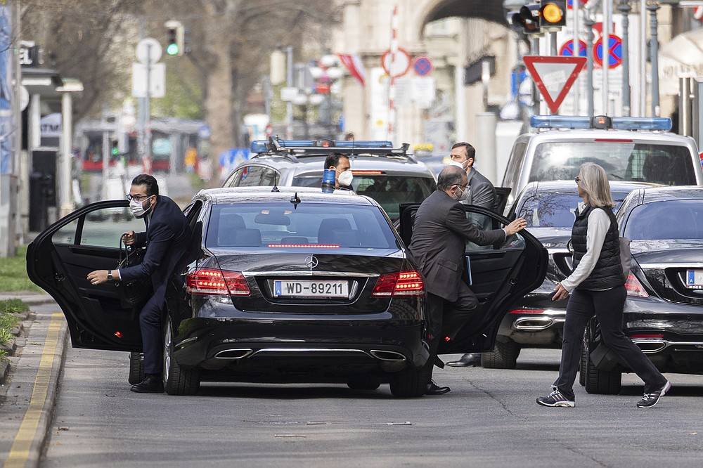 Members of a delegation leave their cars as they arrive in front of the Grand Hotel Wien in Vienna, Austria, Tuesday, April 6, 2021. Foreign ministry officials from the countries still in the accord, the so-called Joint Comprehensive Plan of Action, are meeting in Vienna to push forward efforts to bring the United States back into the 2015 deal on Iran's nuclear program. (AP Photo/Florian Schroetter)