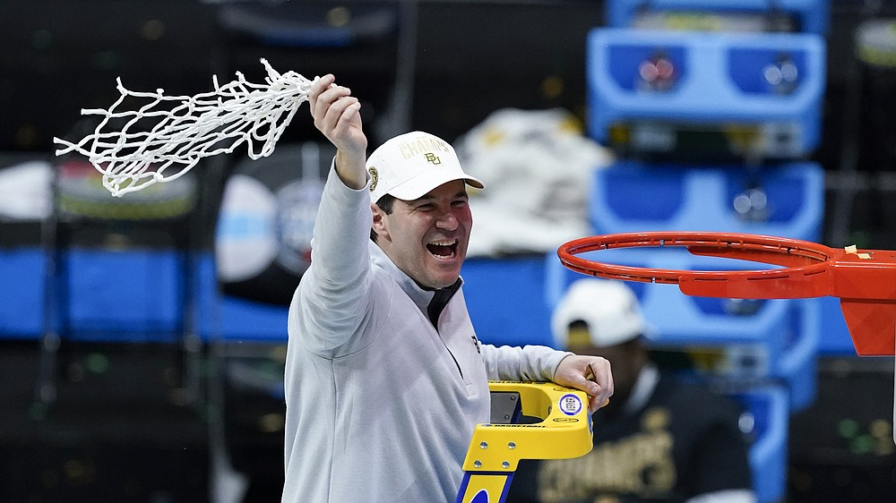Baylor head coach Scott Drew cuts down the net after the championship game against Gonzaga in the men's Final Four NCAA college basketball tournament, Monday, April 5, 2021, at Lucas Oil Stadium in Indianapolis. Baylor won 86-70. (AP Photo/Darron Cummings)