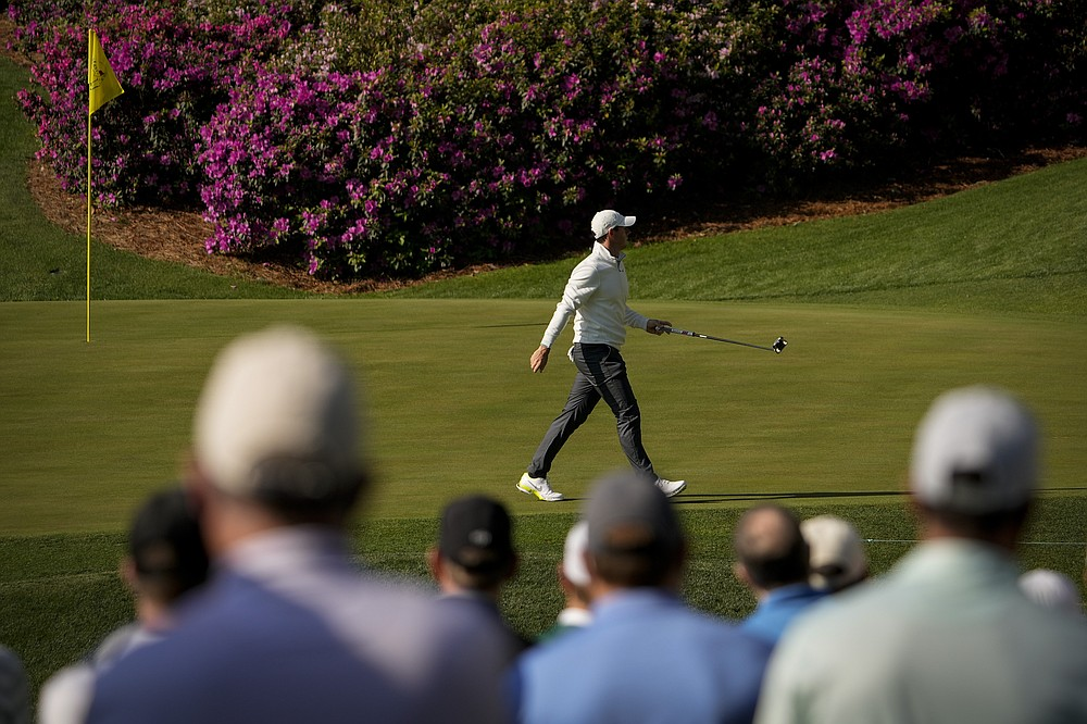 Rory McIlroy, of Northern Ireland, walks across the green on the 13th hole during a practice round for the Masters golf tournament on Tuesday, April 6, 2021, in Augusta, Ga. (AP Photo/David J. Phillip)
