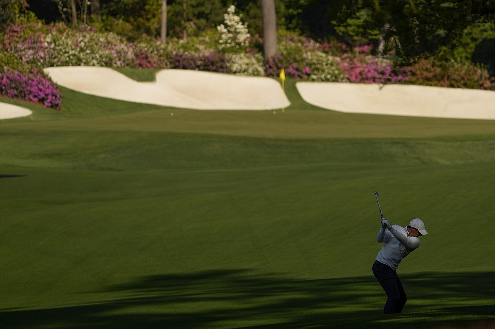 Rory McIlroy, of Northern Ireland, hits from the fairway on the 13th hole during a practice round for the Masters golf tournament on Tuesday, April 6, 2021, in Augusta, Ga. (AP Photo/David J. Phillip)