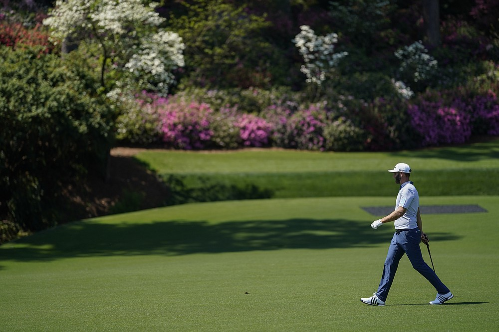 Dustin Johnson walks to the 13th green during a practice round for the Masters golf tournament on Tuesday, April 6, 2021, in Augusta, Ga. (AP Photo/David J. Phillip)