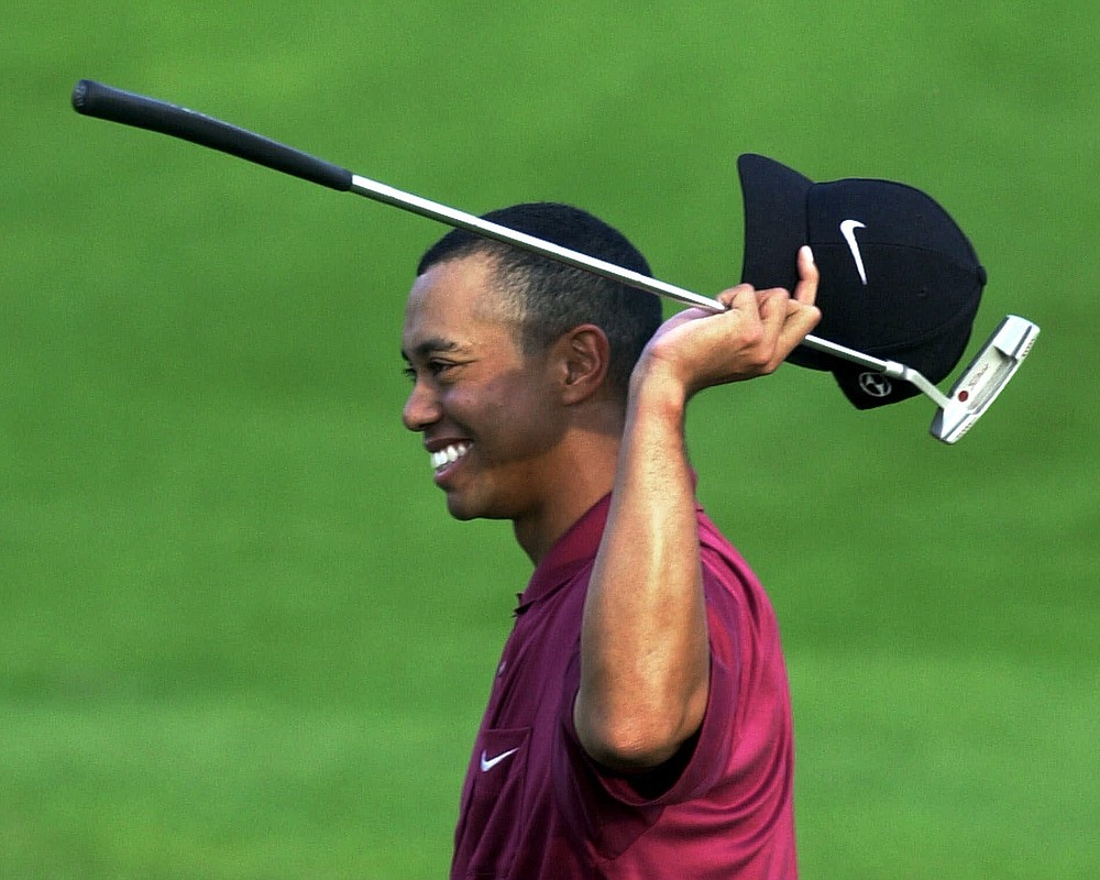 FILE - In this April 8, 2001, file photo, Tiger Woods smiles after winning the Masters at Augusta National Golf Club in Augusta, Ga. It was 20 years ago this week that Woods became the first player to hold all four majors at the same time by winning the Masters. (AP Photo/Amy Sancetta, File)