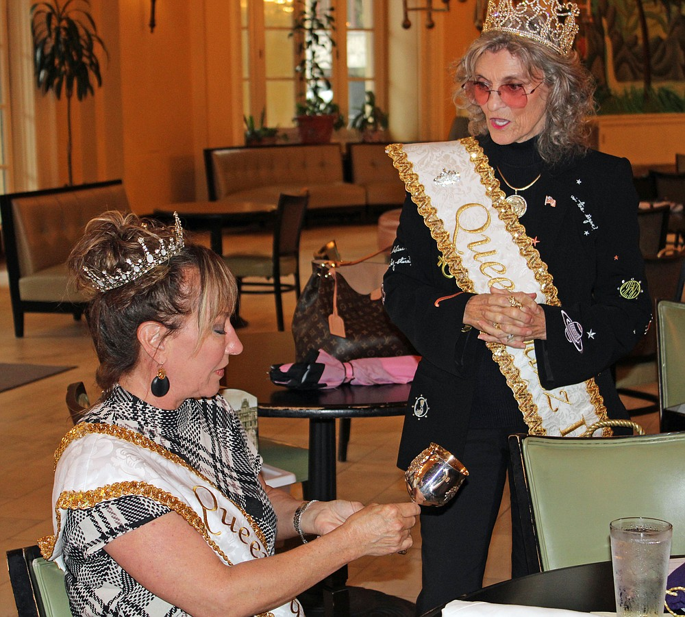 er Royal Highness Beth Gipe Queen Jazz IX, left, is presented with her engraved goblet Wednesday during the annual luncheon of the Hot Spring Jazz Society Royalty by H.R.H. Sharon Turrentine QJII in the lobby of the Arlington Resort Hotel & Spa. - Photo by Tanner Newton of The Sentinel-Record