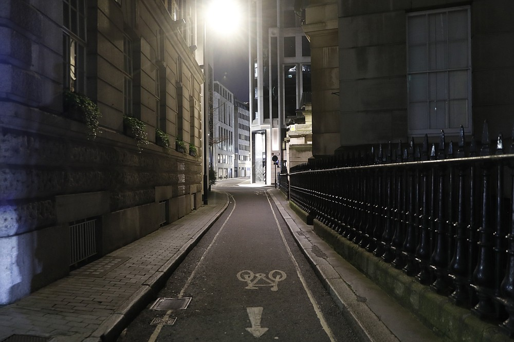 "A view of an empty Gutter Lane in the City of London on Saturday, March 6, 2021. When the pandemic struck, about 540,000 workers vanished from London's financial hub almost overnight. The area known as ""the City"" became a ghost town as many people began working from home. A year on, most haven't returned to the business hub. While many people believe that post-pandemic workflow will become the new normal, skyscrapers are still rising, and city planners say they aren't worried about empty office blocks. (AP Photo/Alastair Grant)"