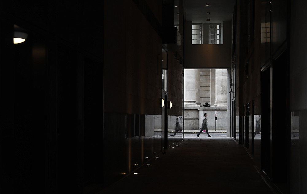 "A man walks past the Royal Exchange in London, Tuesday, April 6, 2021. When the pandemic struck, about 540,000 workers vanished from London's financial hub almost overnight. The area known as ""the City"" became a ghost town as many people began working from home. A year on, most haven't returned to the business hub. While many people believe that post-pandemic workflow will become the new normal, skyscrapers are still rising, and city planners say they aren't worried about empty office blocks. (AP Photo/Alastair Grant)"