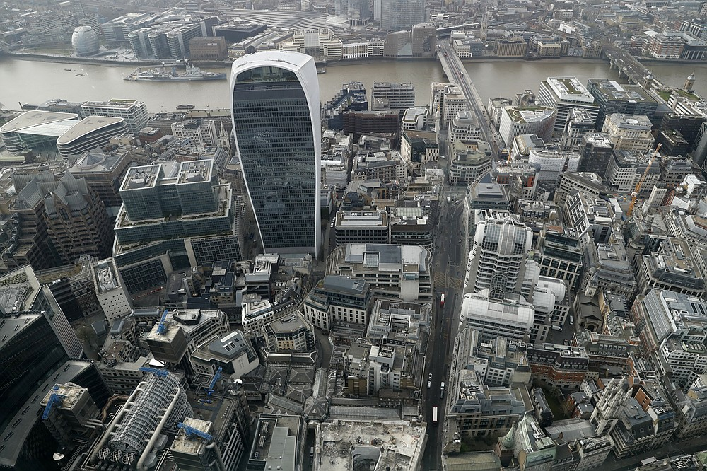 "A view over the City of London taken from the 59th floor of 22 Bishopsgate in London, Thursday, April 1, 2021. When the pandemic struck, about 540,000 workers vanished from London's financial hub almost overnight. The area known as ""the City"" became a ghost town as many people began working from home. A year on, most haven't returned to the business hub. While many people believe that post-pandemic workflow will become the new normal, skyscrapers are still rising, and city planners say they aren't worried about empty office blocks. (AP Photo/Alastair Grant)"