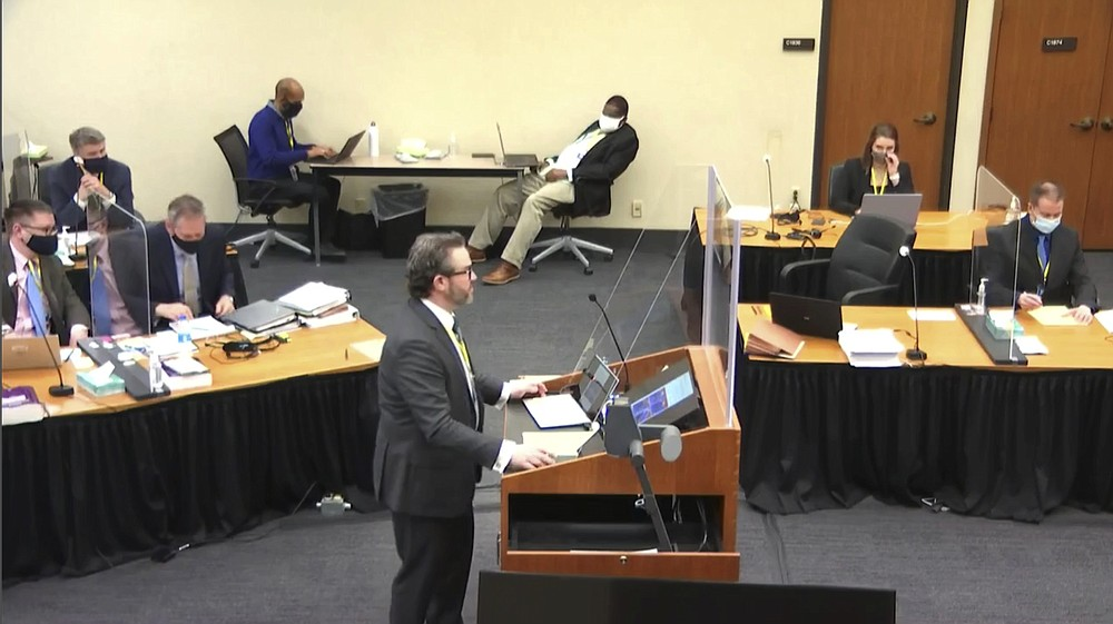 In this image taken from video, defense attorney Eric Nelson questions witness Los Angeles police department Sergeant Jody Stiger, as Hennepin County Judge PeterCahill presides Wednesday, April 7, 2021, in the trial of former Minneapolis police Officer Derek Chauvin at the Hennepin County Courthouse in Minneapolis. Chauvin is charged in the May 25, 2020 death of George Floyd. (Court TV via AP, Pool)