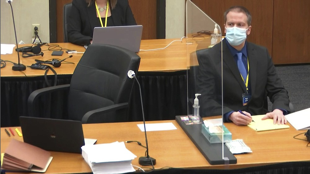 In this image taken from video, former Minneapolis police Officer Derek Chauvin watches as defense attorney Eric Nelson questions witness Los Angeles police department Sergeant Jody Stiger, Wednesday, April 7, 2021, during Chauvin's at the trial at the Hennepin County Courthouse in Minneapolis. Chauvin is charged in the May 25, 2020 death of George Floyd. (Court TV via AP, Pool)